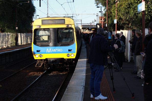 Channel 10 news cameraman filming an up train arrive into Newport from Williamstown