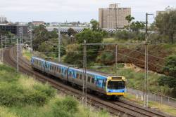 3-car EDI Comeng 335M climbs the grade out of Flemington Bridge on a down Upfield service