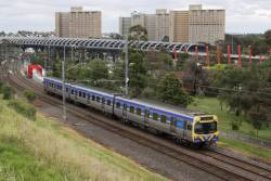 3-car EDI Comeng 354M departs Flemington Bridge station on a down Upfield service