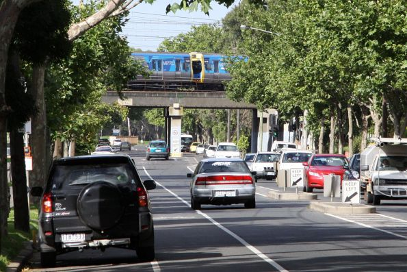 EDI Comeng train on the Sydenham line crosses the Kensington Road overpass in Kensington