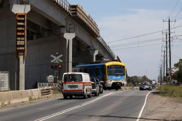No visibility of approaching trains here: a Siemens passes through the Kororoit Creek Road level crossing, soon to be replaced by a second bridge