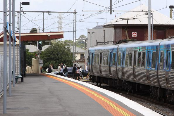 The level crossing finally opens at Yarraville, letting the passengers past