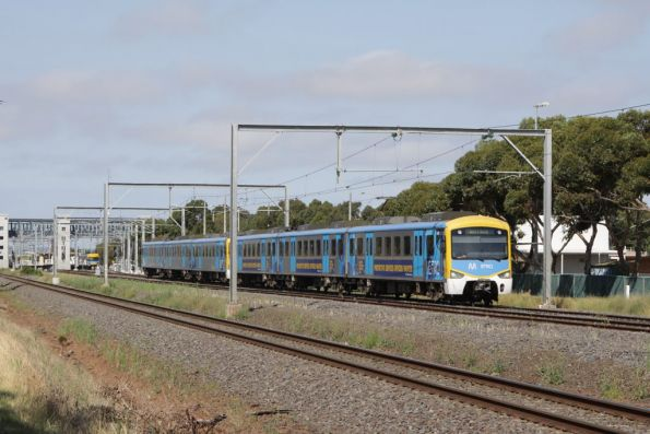 Siemens 840M on the down at Laverton, with advertising on the front set