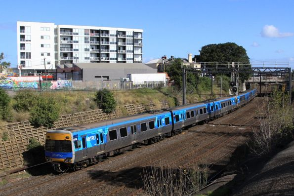 Alstom Comeng 523M trails a down Werribee train at Footscray