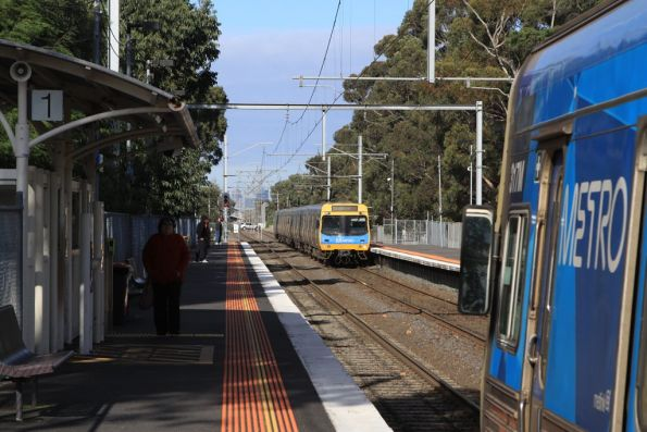 Up and down trains arrive into Fawkner station