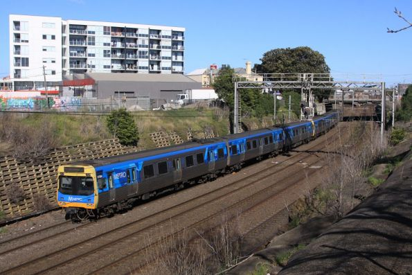 EDI Comeng 378M trails a down Werribee service at Footscray