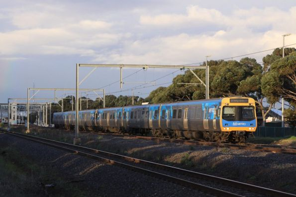 EDI Comeng 423M leads a down Werribee service out of Laverton