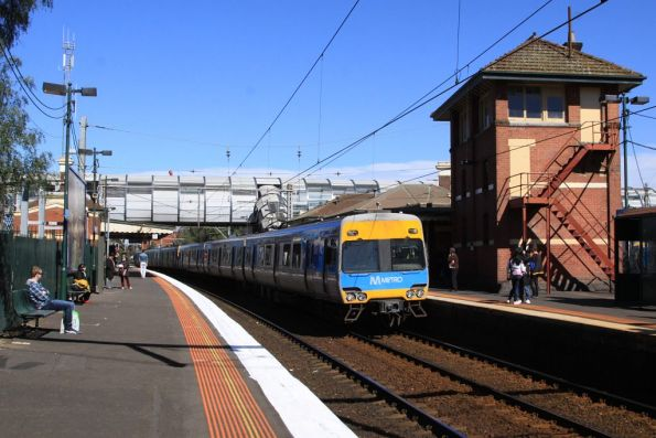 Alstom Comeng 613M arrives into Footscray on the up
