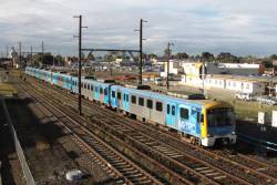 Siemens 707M on a down Sydenham train passes the RRL works at Sunshine