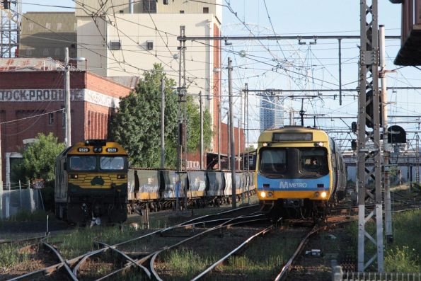 Comeng on a down Craigieburn service passes G529 and H1 on the Kensington grain