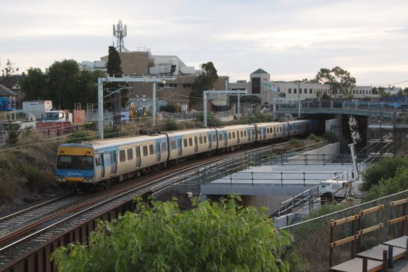 Sunbury-bound Comeng train passes Regional Rail Link works at the down end of Footscray station