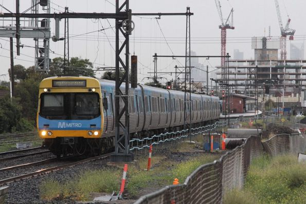 Down Watergardens train departs Middle Footscray