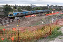 EDI Comeng 355M passes RRL works on the up at Footscray