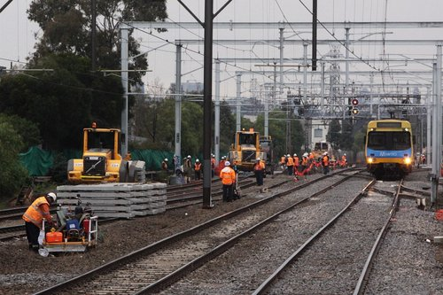 Down train passes the active worksite at South Kensington