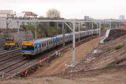 Comeng on a down Werribee train passes through the widened cutting outside Footscray