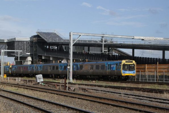 EDI Comeng leads a down train past the future up platform of the new West Footscray station