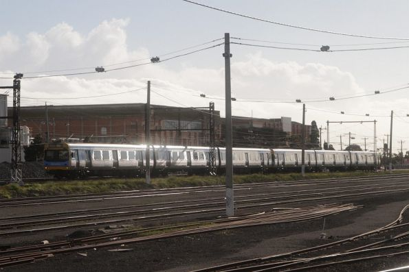 EDI Comeng leads an up train towards West Footscray