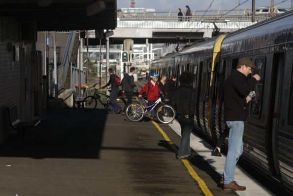 Passengers board an up train at West Footscray