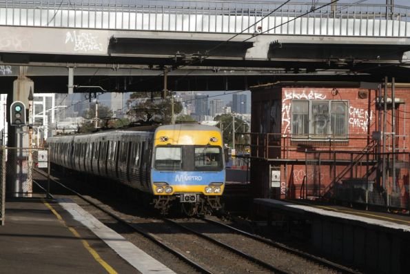 Alstom Comeng passes the soon to be demolished signal box at West Footscray
