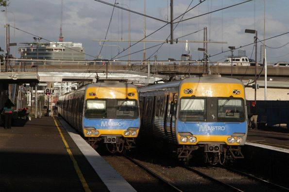 Up and down trains pass on the last day of the original West Footscray station