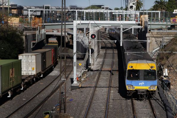 Alstom Comeng on a down Sunbury service passes RRL works outside Footscray