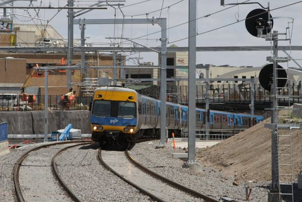 Up Sunbury train crosses the goods lines at Footscray, bound for the new suburban platforms