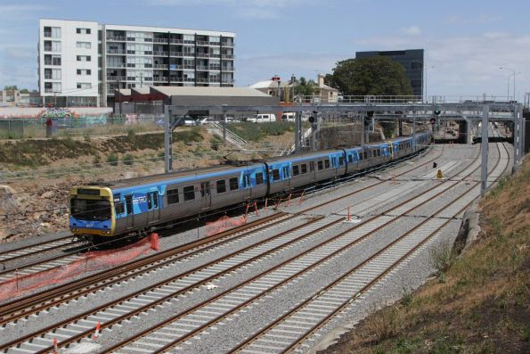 Up Werribee train passes the future RRL and realigned suburban tracks outside Footscray
