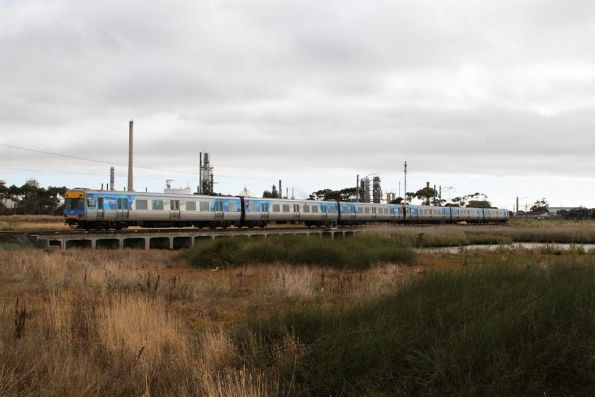 Comeng train on an up Werribee services crosses Kororoit Creek on the Altona loop