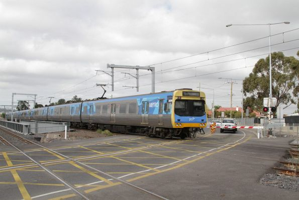 Citybound Comeng crosses the Anderson Road level crossing in Sunshine