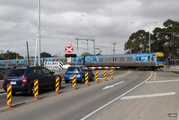 Comeng on a down Sunbury service passes through the temporary slew at the Anderson Road level crossing
