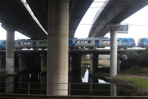 X'Trapolis train crosses Moonee Ponds Creek on an empty car move from Flemington Racecourse