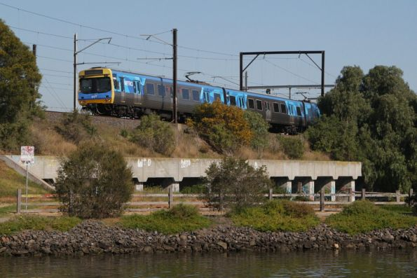 EDI Comeng on an up Sunbury service crosses the Maribyrnong River floodplain