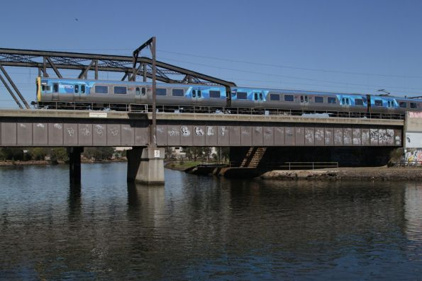 EDI Comeng on an up Sunbury service crosses the Maribyrnong River
