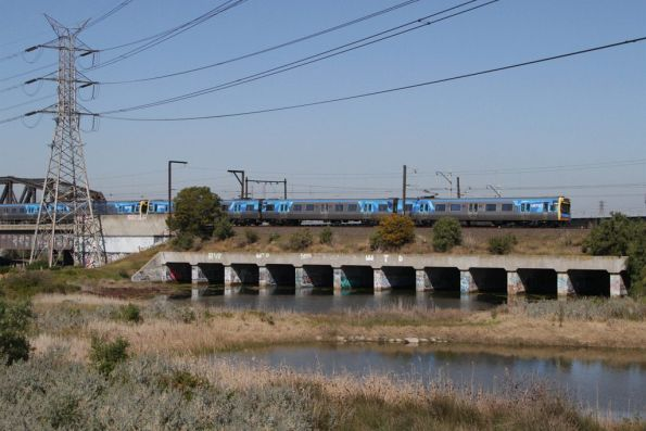 EDI Comeng on a down Sunbury service crosses the Maribyrnong River floodplain