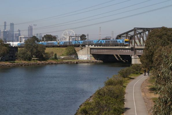 Comeng train crosses the Maribyrnong River bridge on a down Sunbury service