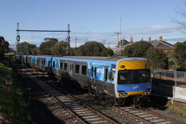 Alstom Comeng 604M on a down Craigieburn service approaches Moonee Ponds
