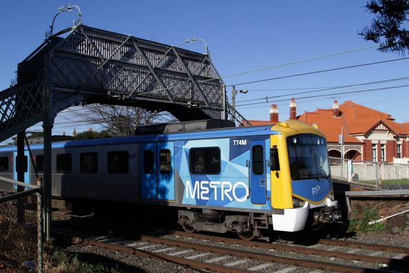 Siemens 774M on a down Craigieburn service, passing under a footbridge south of Moonee Ponds station