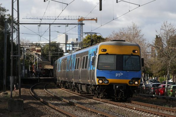 Alstom Comeng 415M departs Moonee Ponds on a down Craigieburn service