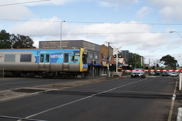 EDI Comeng 308M crosses the Buckley Street level crossing at Essendon