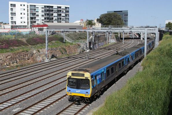 EDI Comeng 539M on an up Sunbury service departs Footscray