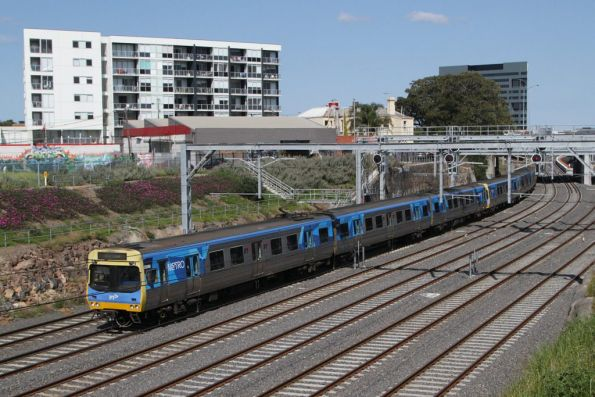 EDI Comeng 550M on an up Werribee service departs Footscray