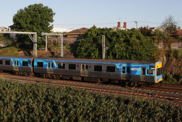 Alstom Comeng 339M heads through the cutting  towards Footscray with a down Sunbury service