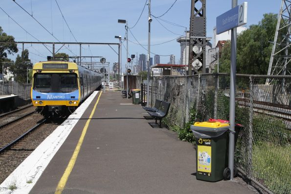 EDI Comeng arrives into South Kensington on a down Williamstown service