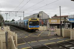 EDI Comeng 455M arrives into Yarraville on the up