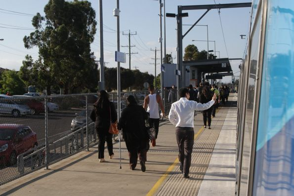 Passengers departs a down Watergardens service at Keilor Plains