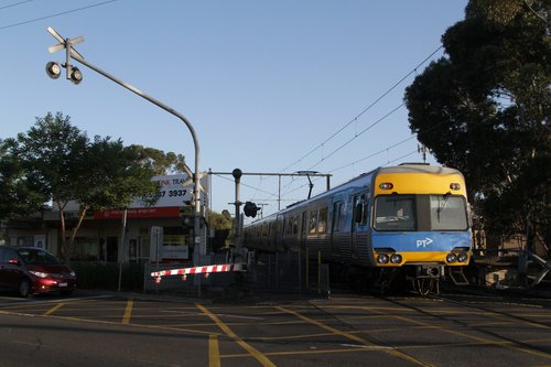 Down train crosses the Main Road level crossing at St Albans