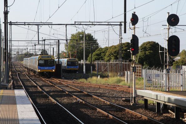 Second St Albans service of the morning passes a stabled train in the yard