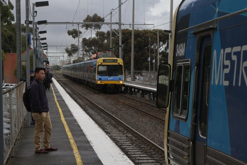 Comeng 349M arrives into Ginifer on the up, as a down train arrives into the other platform