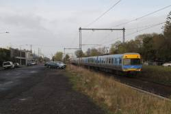 Alstom Comeng leads an up service out of Spotswood