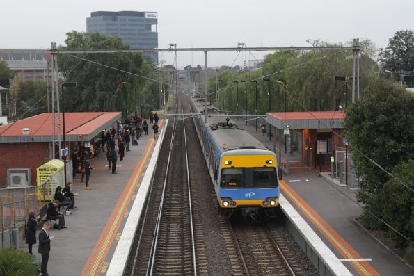 Alstom Comeng passes through Seddon with a down Werribee service